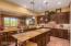 Granite counters and walnut cabinets w/stylish pulls.