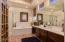 Spacious master bathroom with separate standing shower and soaker tub, ceramic tile and large vanity.
