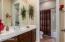 Jack & Jill bathroom. Each has it's own vanity and sink, shared tub & toilet.