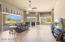 This Large Family Room Is Adjoined With The Kitchen For Lots Of Interaction With Family and Friends. Great Views of the Back Yard Oasis As Well.