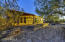 Fully detached guest house with separate office and 2 car carport.