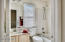 Hallway bathroom with combo shower/tub upstairs