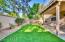 Backyard side view showing porch, balancy and greenery