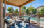The covered patio is on the north side with a removable pool fence.