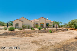 comfortable lifestyle in this 3,476 square feet, heavily-appointed custom home on 1.25 acres (54,450 square feet) of pristine desert dotted with saguaro cacti as well as native mesquite and palo verde trees. North/south exposure! Room for sport courts, horses, animals, garden, additional structures. Home constructed in 2008-2009. Cave Creek zip code but on Maricopa County land conveniently situated 1 mile west of City of Scottsdale and 1 mile east of City of Phoenix.