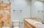 Stunning travertine tile shower