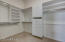 Spacious walk-in master closet with built-ins.