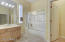 Large bathroom that has an entrance into the 4th bedroom and the hallway