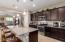 Kitchen is Open to Great Room - with Pendant and Recessed Lighting