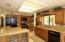 Kitchen island features glass paneled doors.