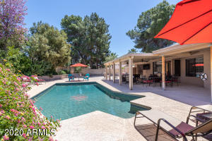 Massive RESORT STYLE pool! HEATED POOL! GIGANTIC PATIO, POOL, BACKYARD WITH SPORTS COURT, PUTTING GOLF COURSE, AND A BIG GRASSY AREA!