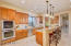 Tall Kitchen Cabinets, Solid Raised Panel Doors; Built-In GE Monogram Double Ovens and Microwave