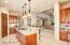 Spacious Open Kitchen; Phone Desk Area; Upgraded Fixtures; Travertine Tile Floor