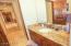 All Baths Have Upgraded Faucets & Light Fixtures; Granite; Solid Wood Knotty Alder Door