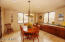 Sunny Breakfast Room; Built-in Long Built-in Buffet w/Granite top; French Doors to Large Patio; Windowed 3 sides!
