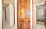 Solid Knotty Alder Doors; High Barrel Ceilings; Travertine Tile Floors