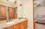 Granite vanity tops and raised panel doors (plus exquisite lighting) in ALL baths + laundry!