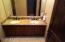 Granite Top Bath Vanities, with Travertine Tile Floors and matching Walk-in Travertine Tile Shower, just behind.