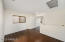 Upstair loft area with wood plank floors for additional living space.