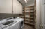 Ample storage with cabinetry and shelves.
