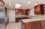 Wolf convection/steam oven, Sub-Zero refrigerator, granite counters, designer tile backsplash and large walk in pantry