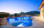 Crystal blue pool with soothing water feature.
