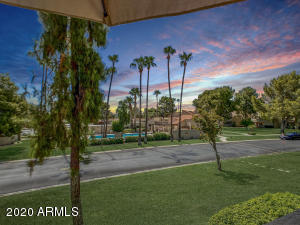 Balcony view overlooking the Palms and Pool - Breathtaking Resort Living