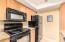 Kitchen has built in Microwave and Flat Surface Range