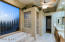 Master Bath features jetted tub, privacy glass, ceiling fan & tiled walk-in shower