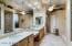 Dual vanities, seating & ceiling fan in Master Bath