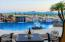 Sparkling pool with grotto, waterfall, sheers, color wheel and swim up pool bar