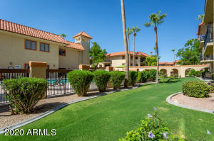 Wonderfully manicured landscaping by the pool courtyard makes this property very special.