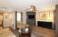 FOYER ENTRANCE AND LIVING ROOM W/ FIREPLACE & WALL MOUNTED TV INCLUDED!