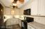 TOTALLY RECONFIGURED UPDATED KITCHEN w/ EXTRA CABINET SPACE!
