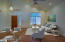 Front Living/Dining Room, is a great place for family and friends to gather. Light and bright with neutral flooring.