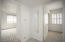 Bedroom hallway has full length mirror