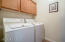 Laundry room has add'l linen cabinet opposite W/D that stay