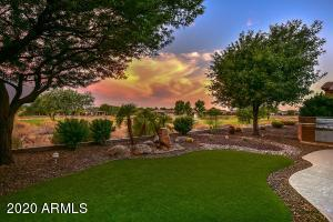 Beautiful synthetic grass, extended patio with BBQ, large shade trees, and gorgeous golf views.