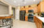Eat-In Kitchen with New Charcoal Stainless Appliances and Pantry