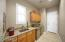 Sink, storage cabinets and granite top