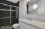 Dual Sinks & Floor to Ceiling Custom Tiled Shower