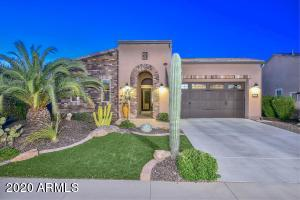 Stone elevation, paver entry, synthetic grass, and lush landscaping!