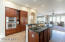 Cherry cabinets, granite counters, wall ovens.