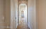 Lovely arched hallway to split bedrooms and office. Large coat closet, additional cabinets and separate exit to courtyard in this hallway.