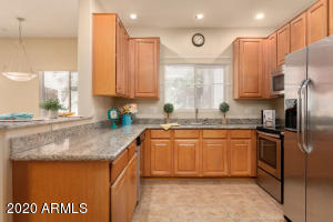 Kitchen with upgraded maple cabinets & granit counters
