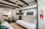 """The """" Bunk-house"""" is complete with a built-in bed-system. Can convert to standard room or office as well."""