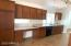 Loads of cabinets of both side in the kitchen