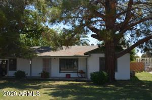 Charming home surrounded by trees on 1/2 acre lot