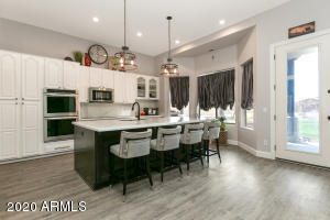 Remodeled Kitchen with Induction Cooktop, Quartz Counters and Stainless Appliances