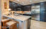 Dacor appliances and generous cabinetry including pantry